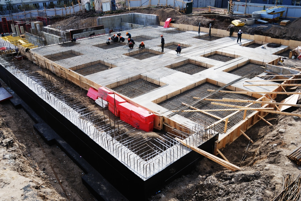 Workers are constructing concrete foundation for commercial space