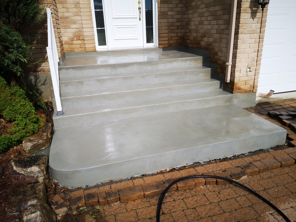 Example of different steps to properly prepare and resurface an old chipped concrete staircase to a renewed finish.