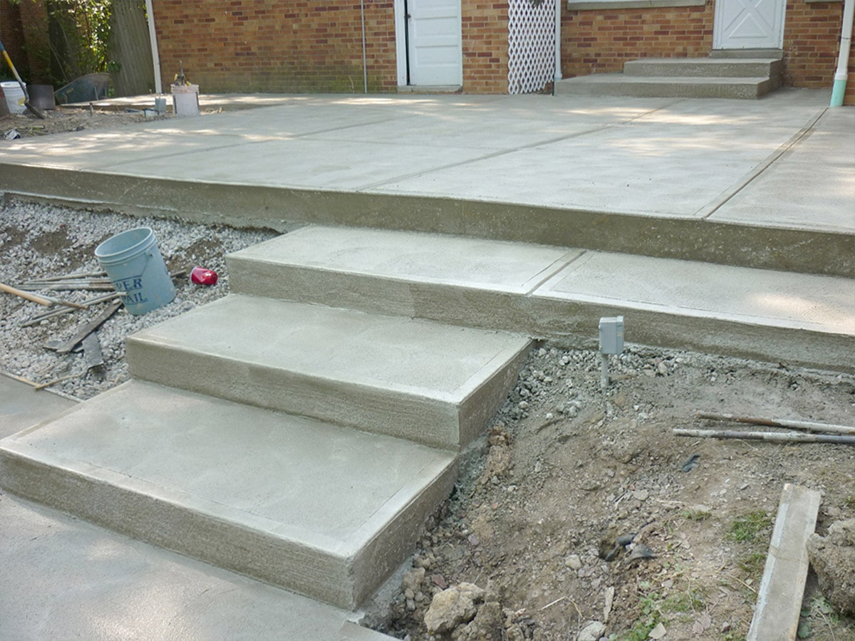 Newly constructed concrete patio for courtyard stairs