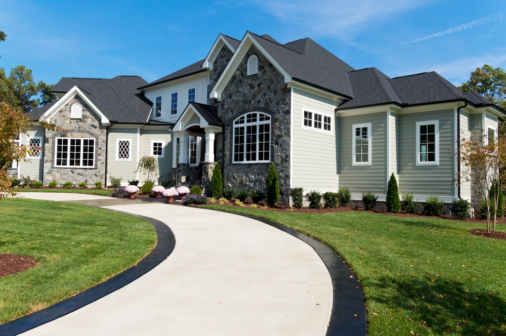 A newly residential home completed concrete construction with a beautiful driveway