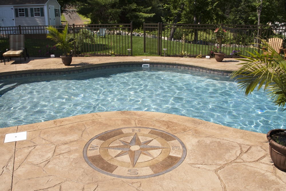 Beautiful stamped patio ovelays installed in a swimming pool area