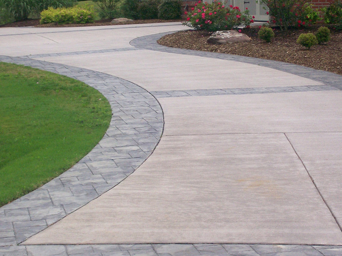 Newly constructed driveway in a garden using beautiful concrete patio design